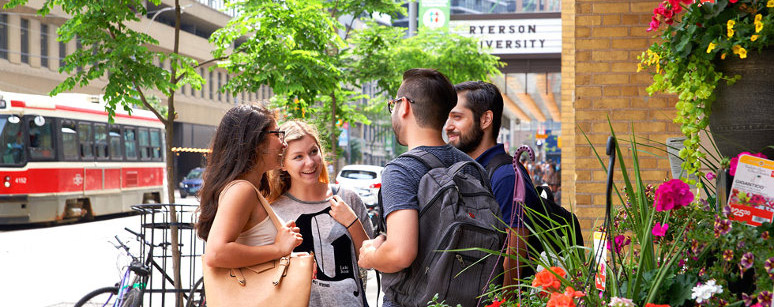Friends meeting up outside Parkside student residence.